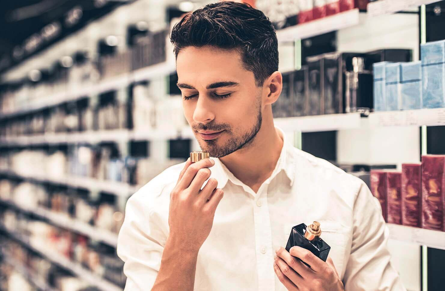 man smelling cologne