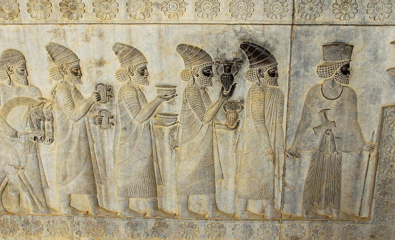 stone carving of ancient persians and perfume