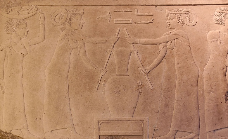 ancient painting of people making perfume