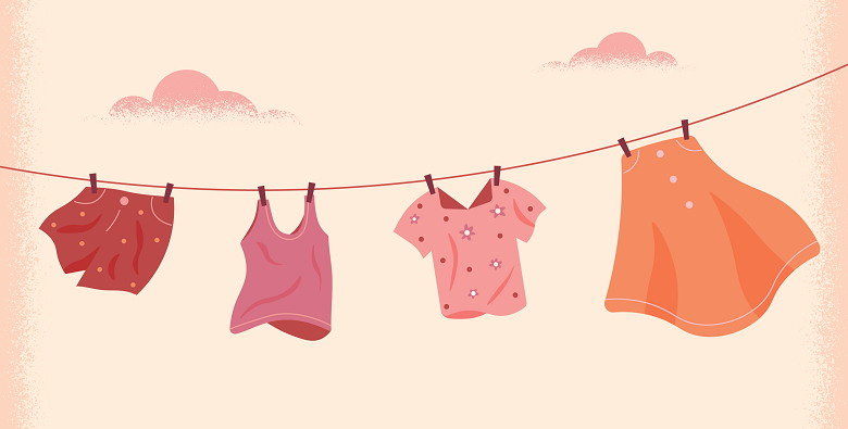 two shirts and two skirts hanging on a clothesline to dry