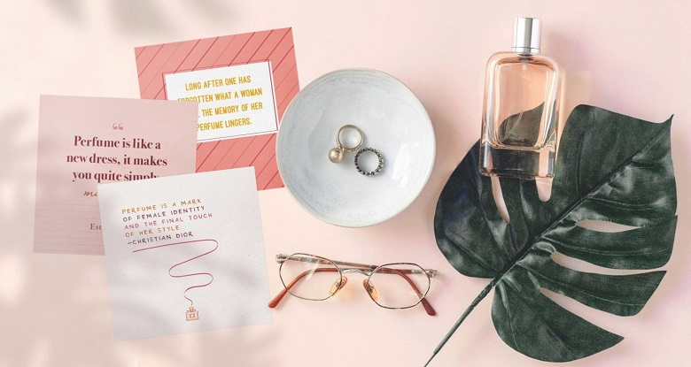printable perfume quotes sitting with jewelry, glasses and perfume bottle - mockup
