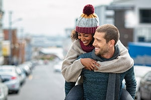 young couple walk through the city wearing winter fragrances